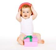 有礼物的滑稽的婴孩 免版税库存照片