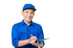 Азиатский работник доставляющий покупки на дом Стоковые Фото