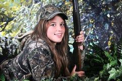 被着陆的青少年的猎人 库存照片