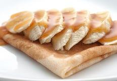 薄煎饼用蜂蜜 免版税库存照片