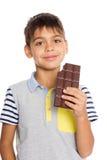 快乐的小男孩用巧克力 库存照片