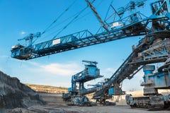 采掘机械在矿 免版税库存照片