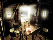 在雪下的老原木小屋 图库摄影