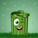 在草的滑稽的垃圾桶 库存图片