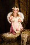 桃红色圣诞节天使女孩 免版税库存图片