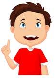 指向与手指的小男孩动画片 免版税库存图片