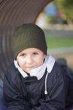 Мальчик на спортивной площадке Стоковое фото RF