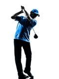 Силуэт качания гольфа игрока в гольф человека играя в гольф Стоковые Изображения