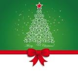 绿色圣诞树星丝带绿色背景 免版税库存照片