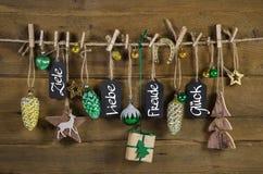 圣诞节与德国文本目标的,爱,乐趣的贺卡和 库存照片