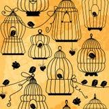 与装饰鸟笼剪影的无缝的样式 免版税库存照片