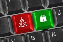 与圣诞节关键字的计算机键盘 免版税库存照片
