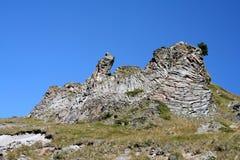 Ο βράχος - ένα πουλί με τα ανοικτά φτερά Στοκ εικόνα με δικαίωμα ελεύθερης χρήσης