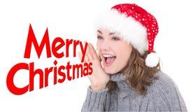 圣诞老人帽子呼喊的年轻美丽的妇女 免版税图库摄影