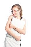爱她的膝上型计算机的微笑的女商人 图库摄影