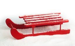 木红色雪撬 图库摄影