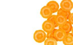 在白色隔绝的新鲜的切片红萝卜 库存照片