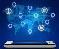 手机和一张世界地图与连接象 库存图片