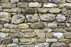 老石制品墙壁 免版税库存照片