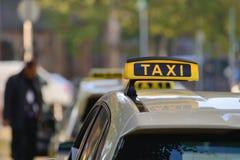 背景是象可能签署出租汽车使用 免版税库存图片