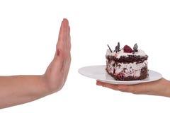 对蛋糕说不 肥胖病问题的概念 免版税库存图片
