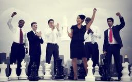 商人庆祝赢取的下棋比赛概念 库存图片