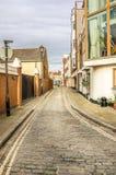狭窄被修补的街道 免版税库存照片