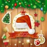 与冷杉和圣诞老人的帽子的圣诞节背景 库存图片