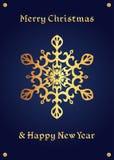 在深刻的蓝色背景的典雅的金黄雪花,圣诞卡 免版税库存图片
