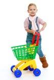 有玩具卡车的迷人的小女孩 免版税库存图片