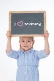 拿着黑板的孩子画象 图库摄影