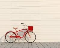 有篮子的在白色墙壁前面,背景红色减速火箭的自行车 免版税库存照片