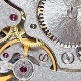 从葡萄酒时钟的钢运动的背景 库存图片