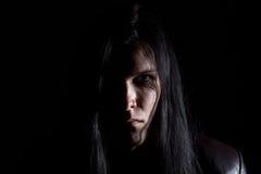 深色的人的照片有长的头发的 库存图片