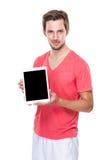 供以人员与片剂黑屏的展示  免版税库存图片