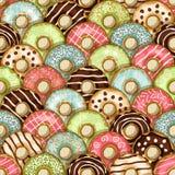 油炸圈饼无缝的样式 库存照片