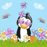 与花的企鹅 免版税库存照片