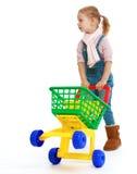 有玩具卡车的迷人的小女孩 免版税库存照片