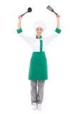 厨师制服的年轻可爱的妇女有厨房工具的-充分 库存照片