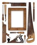 拼贴画工作木头用工具加工形成框架的木匠 免版税库存图片