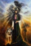 在一位神秘的神仙的女教士的帆布的美好的油画有一头狼的由她的边 图库摄影