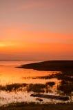 在竹木筏的剧烈的日出 库存图片