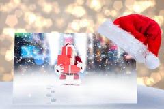 圣诞老人帽子的综合图象在海报的 免版税库存照片