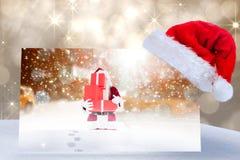 圣诞老人帽子的综合图象在海报的 图库摄影