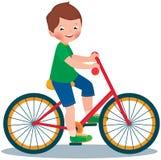 自行车的男孩 库存图片