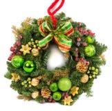 圣诞节在白色隔绝的装饰花圈 库存图片