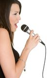 女孩唱歌 库存照片