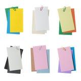 各种各样的纸笔记的汇集与在白色隔绝的夹子的 库存照片