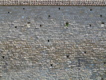 与屋顶的中世纪墙壁纹理 免版税库存照片