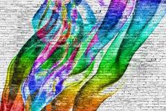 在砖墙的抽象五颜六色的绘画 库存图片